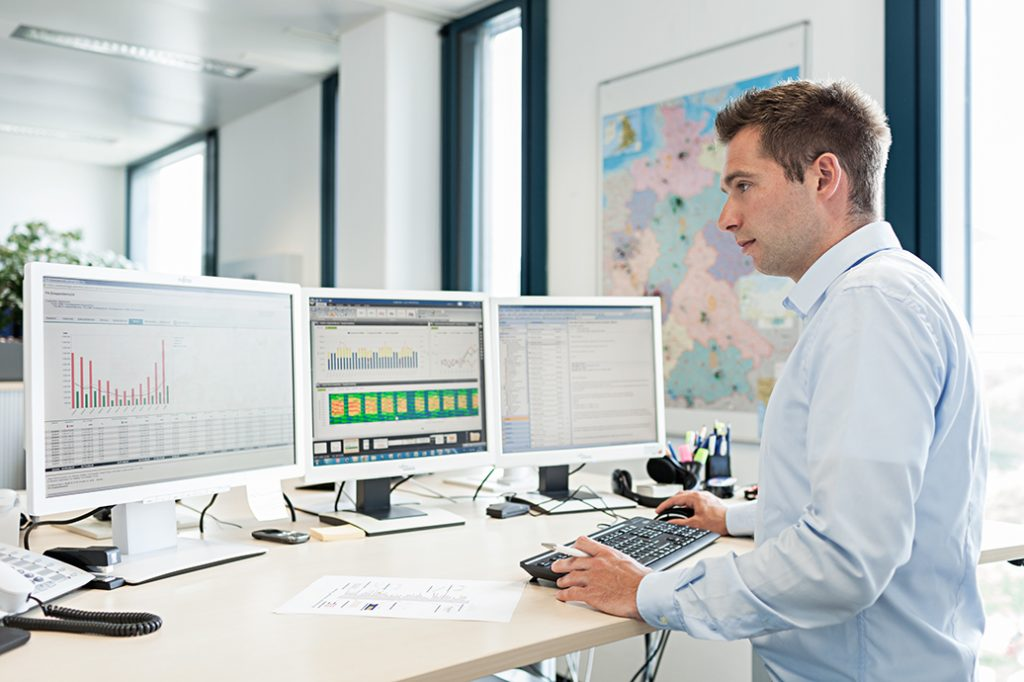 Facility manager monitoring energy consumption on a computer